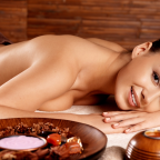 Woman in spa receiving honey massage photo
